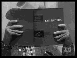 Apprentice lawyer Tom Brewster reading a lawbook